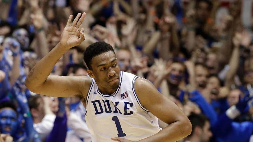 Duke's Jabari Parker reacts following a basket against North Carolina during the first half of an NCAA college basketball game in Durham, N.C., Saturday, March 8, 2014. (AP Photo/Gerry Broome)