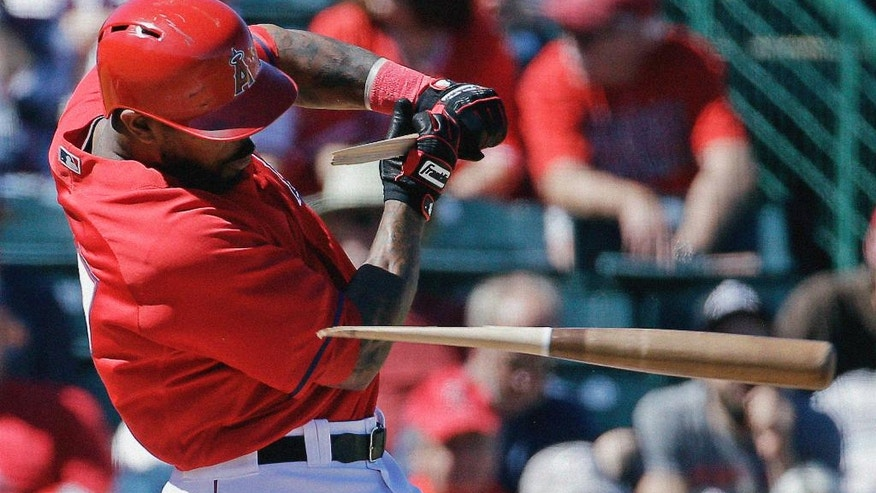 Los Angeles Angels' Howie Kendrick breaks his bat as he grounds out during the first inning of an exhibition spring baseball game against the Cincinnati Reds, Sunday, March 9, 2014, in Tempe, Ariz. (AP Photo/Morry Gash)