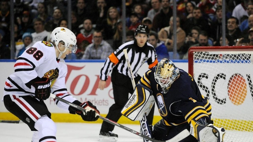 Chicago Black Hawks right winger Patrick Kane (88) gets stopped on a breakaway by Buffalo Sabres goaltender Jhonas Enroth (1), of Sweden, during the second period of an NHL hockey game in Buffalo, N.Y., Sunday, March 9,  2014. (AP Photo/Gary Wiepert)