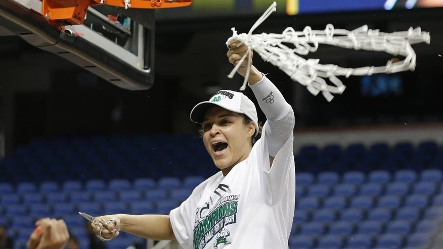 Notre Dame's Kayla McBride celebrates after defeating Duke in the NCAA college basketball championship game of the Atlantic Coast Conference tournament in Greensboro, N.C., Sunday, March 9, 2014. Notre Dame won 69-53. (AP Photo/Chuck Burton)