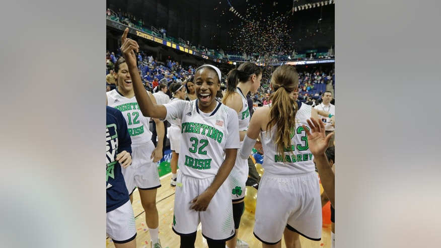 Notre Dame's Jewell Loyd (32) celebrates with teammates   after winning the NCAA college basketball championship game over Duke in the Atlantic Coast Conference tournament in Greensboro, N.C., Sunday, March 9, 2014. Notre Dame won 69-53. (AP Photo/Chuck Burton)