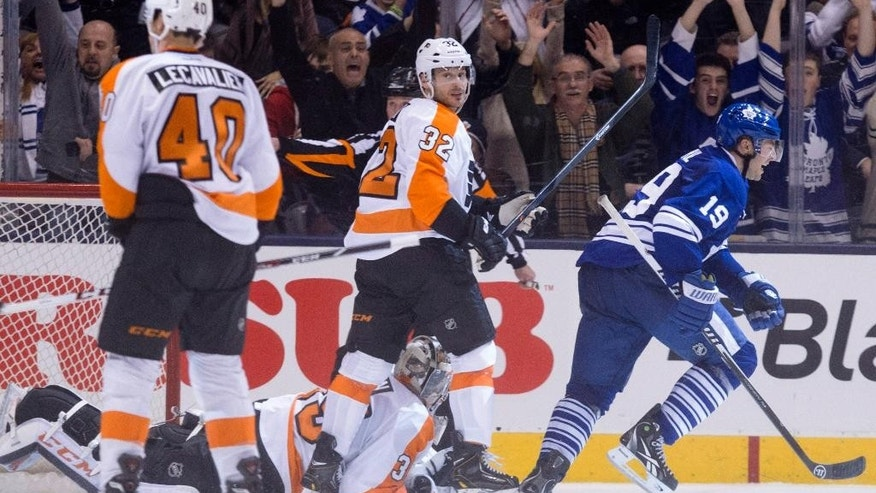 Toronto Maple Leafs' Joffrey Lupul (19) celebrates after scoring the game winning overtime goal as Philadelphia Flyers' Mark Streit (32) looks over at Flyers' Vincent Lecavalier during an NHL hockey game, Saturday, March 8, 2014 in Toronto. (AP Photo/The Canadian Press, Chris Young)