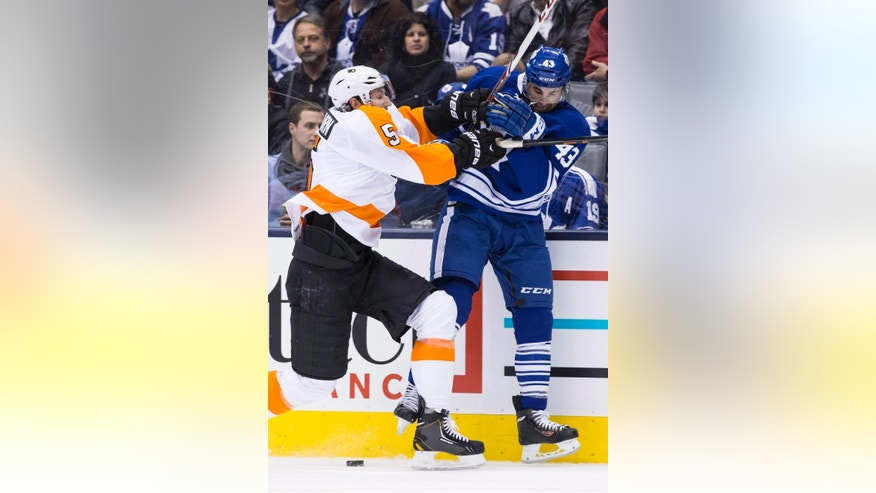 Toronto Maple Leafs' Nazem Kadri, right, battles for the puck with Philadelphia Flyers' Braydon Coburn during the second period of an NHL hockey game, Saturday, March 8, 2014 in Toronto. (AP Photo/The Canadian Press, Chris Young)
