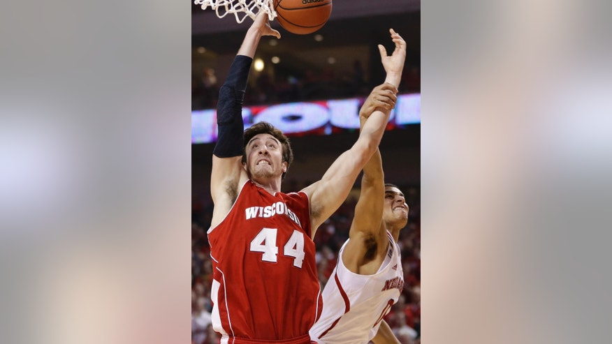 Nebraska's Tai Webster (0) fouls Wisconsin's Frank Kaminsky (44) in the first half of an NCAA college basketball game in Lincoln, Neb., Sunday, March 9, 2014. (AP Photo/Nati Harnik)