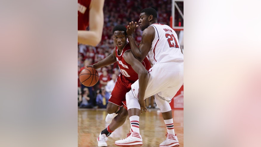 Wisconsin's Nigel Hayes (10) tries to get around Nebraska's Leslee Smith (21) in the first half of an NCAA college basketball game in Lincoln, Neb., Sunday, March 9, 2014. (AP Photo/Nati Harnik)
