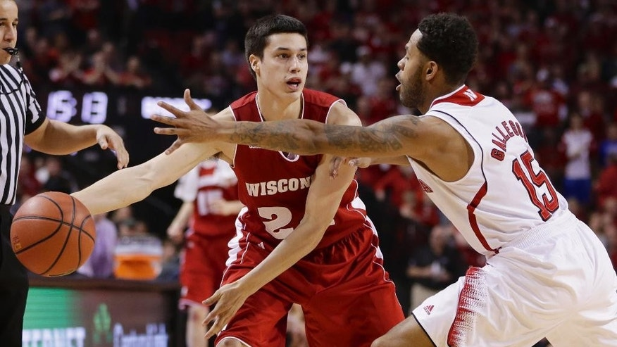 Wisconsin's Bronson Koenig (24) is guarded by Nebraska's Ray Gallegos (15) in the first half of an NCAA college basketball game in Lincoln, Neb., Sunday, March 9, 2014. (AP Photo/Nati Harnik)