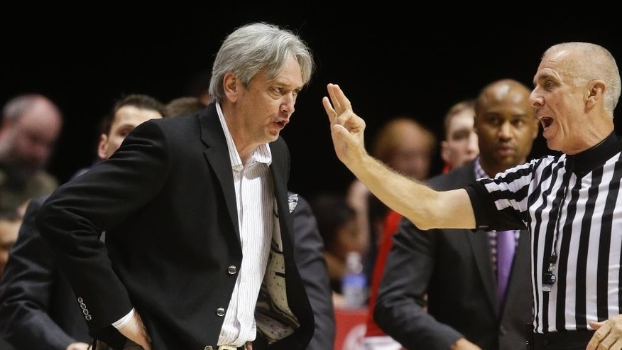 New Mexico coach Craig Neal disagrees with a referee's call during the first half of a NCAA college basketball game against San Diego State Saturday, March 8, 2014, in San Diego. (AP Photo/Lenny Ignelzi)