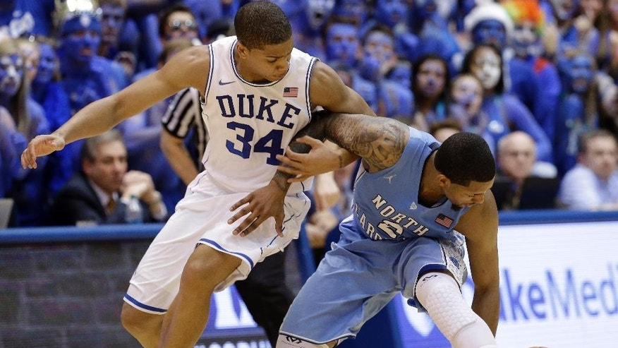 Duke's Andre Dawkins (34) and North Carolina's Leslie McDonald (2) chase a loose ball during the second half of an NCAA college basketball game in Durham, N.C., Saturday, March 8, 2014. Duke won 93-81. (AP Photo/Gerry Broome)