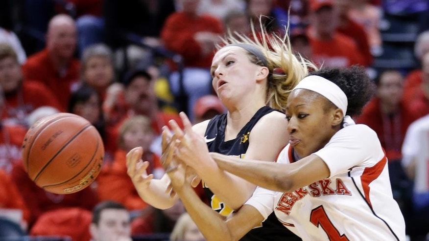 Nebraska guard Tear'a Laudermill, right, and Iowa guard Melissa Dixon fight for the ball in the first half of an NCAA college basketball game in the finals of the Big Ten women's tournament in Indianapolis, Sunday, March 9, 2014. (AP Photo/Michael Conroy)