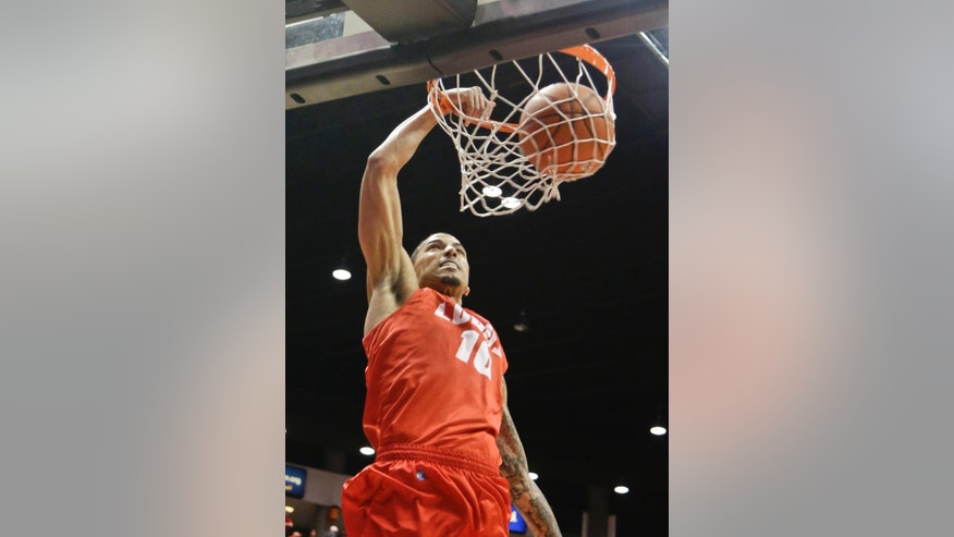 New Mexico guard Kendall Williams dunks against San Diego State  during the second half of a NCAA college basketball game Saturday, March 8, 2014, in San Diego. New Mexico built a 14 point lead only to lose 51-48 and San Diego State captured the Mountain West Conference regular season championship. (AP Photo/Lenny Ignelzi)