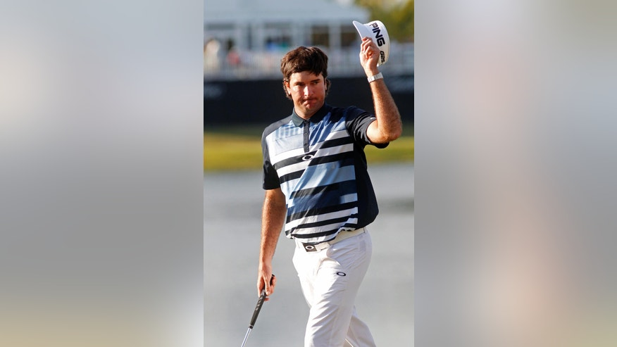 Bubba Watson raises his hat on the 18th green during the final round of the Cadillac Championship golf tournament Sunday, March 9, 2014, in Doral, Fla. (AP Photo/Marta Lavandier)