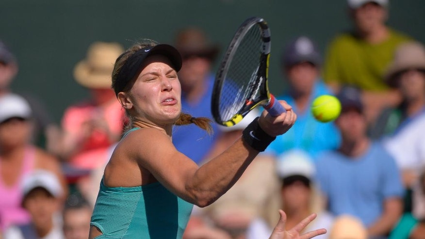 Eugenie Bouchard, of Canada, makes a return against Sara Errani, of Italy, in a match at the BNP Paribas Open tennis tournament on Sunday, March 9, 2014, in Indian Wells, Calif. Bouchard won the match 6-3, 6-3. (AP Photo/Mark J. Terrill)