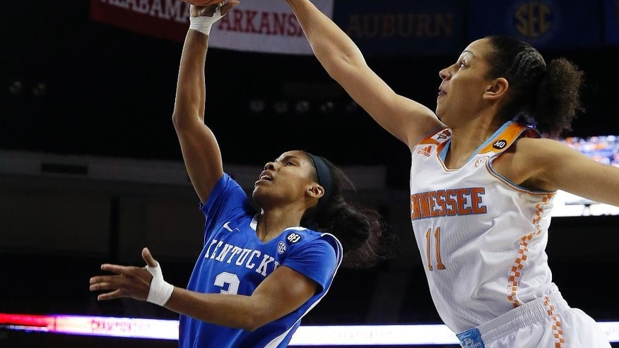 Tennessee's Cierra Burdick (11) gets a hand on a shot by Kentucky's Janee Thompson (3) in the first half of an NCAA college basketball game in the finals of the Southeastern Conference women's basketball tournament Sunday, March 9, 2014, in Duluth, Ga. (AP Photo/John Bazemore)