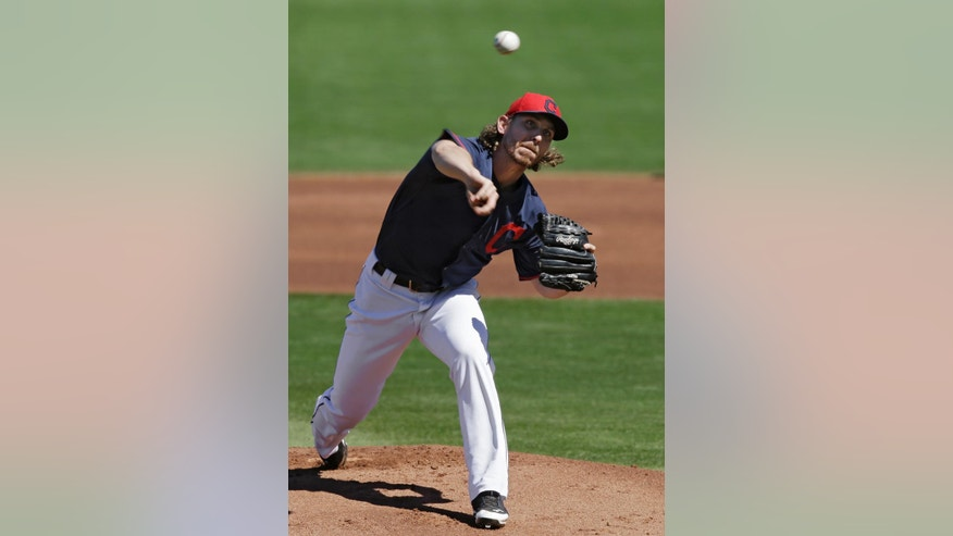 Cleveland Indians starting pitcher Josh Tomlin delivers against the Milwaukee Brewers in the first inning of a spring exhibition baseball game on Sunday, March 9, 2014, in Goodyear, Ariz. (AP Photo/Mark Duncan)