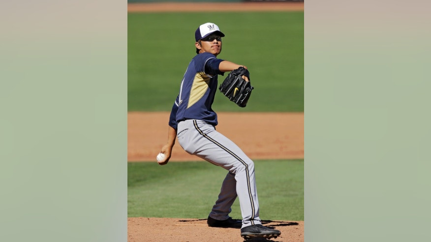 Milwaukee Brewers starting pitcher Wei-Chung Wang, from Taiwan, delivers against the Cleveland Indians in the fifth inning of a spring exhibition baseball game on Sunday, March 9, 2014, in Goodyear, Ariz. (AP Photo/Mark Duncan)
