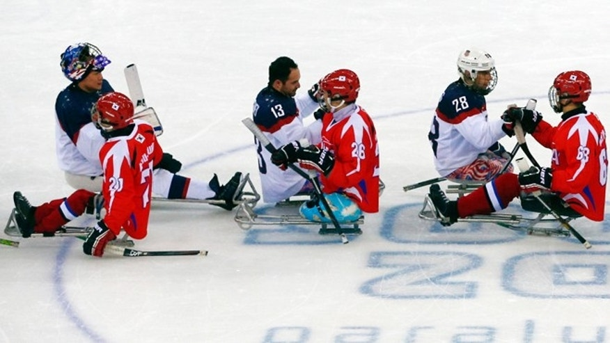 March 9, 2014: South Korea's and United States' players shake hands after their ice sledge hockey match at the 2014 Winter Paralympics in Sochi, Russia, Sunday, March 9, 2014. United States won 3-0.
