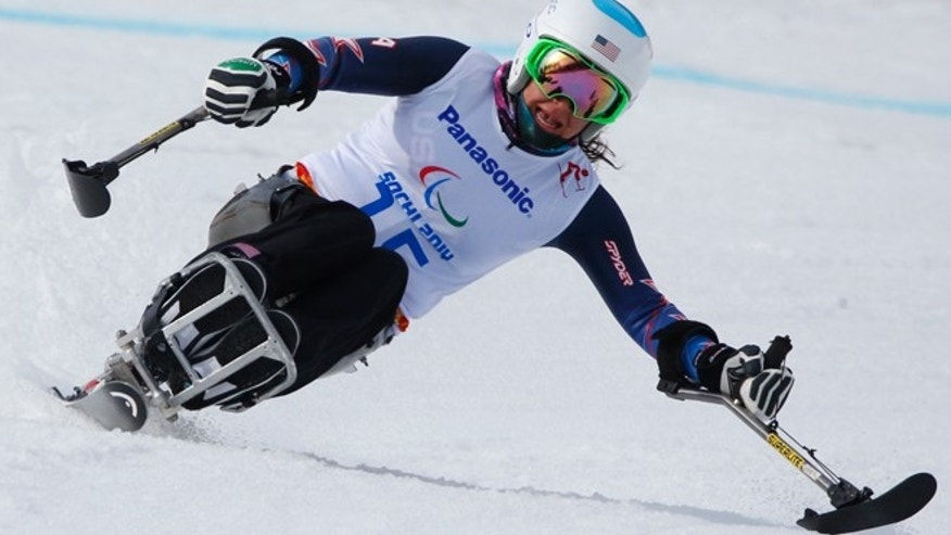 March 8, 2014: United States Alana Nichols races to win her silver medal in the women's downhill, sitting skiing event at the 2014 Winter Paralympic, in Krasnaya Polyana, Russia.