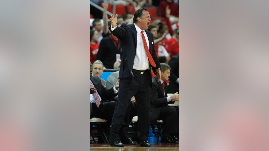 North Carolina State's coach Mark Gottfried reacts to a  call during the first half of the NCAA college basketball game  against Boston College at PNC Arena in Raleigh, N.C., Sunday, March 9, 2014.   (AP Photo/The News & Observer, Ethan Hyman )  Mandartory Credit