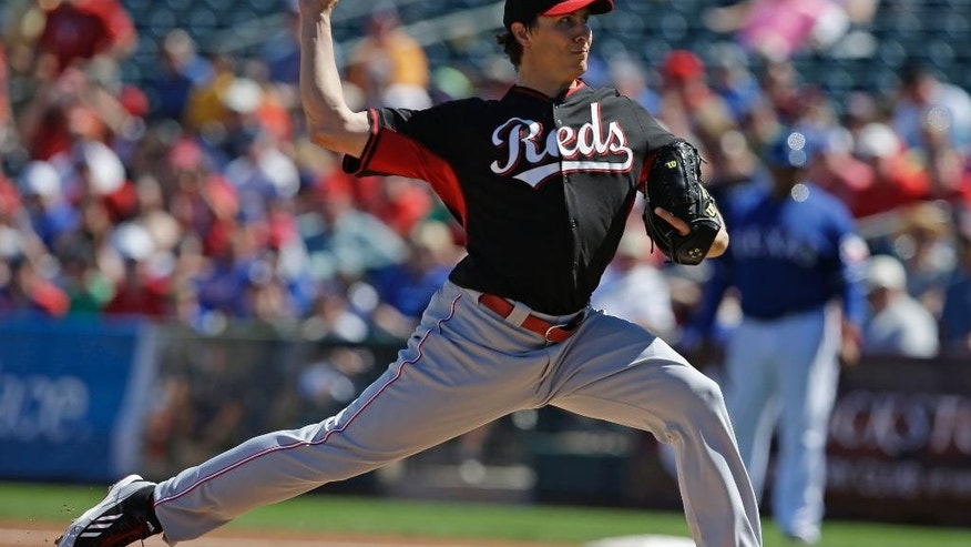 Cincinnati Reds starting pitcher Homer Bailey throws during the first inning of a spring exhibition baseball game, Monday, March 10, 2014, in Suprise, Ariz. (AP Photo/Darron Cummings)
