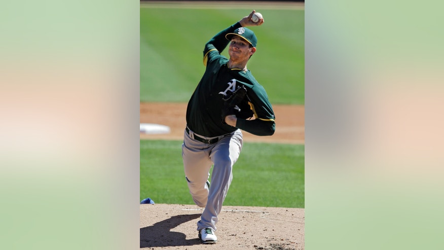 Oakland Athletics starting pitcher Jarrod Parker delivers against the Los Angeles Dodgers in the first inning of a spring exhibition baseball game Monday, March 10, 2014, in Glendale, Ariz. (AP Photo/Mark Duncan)