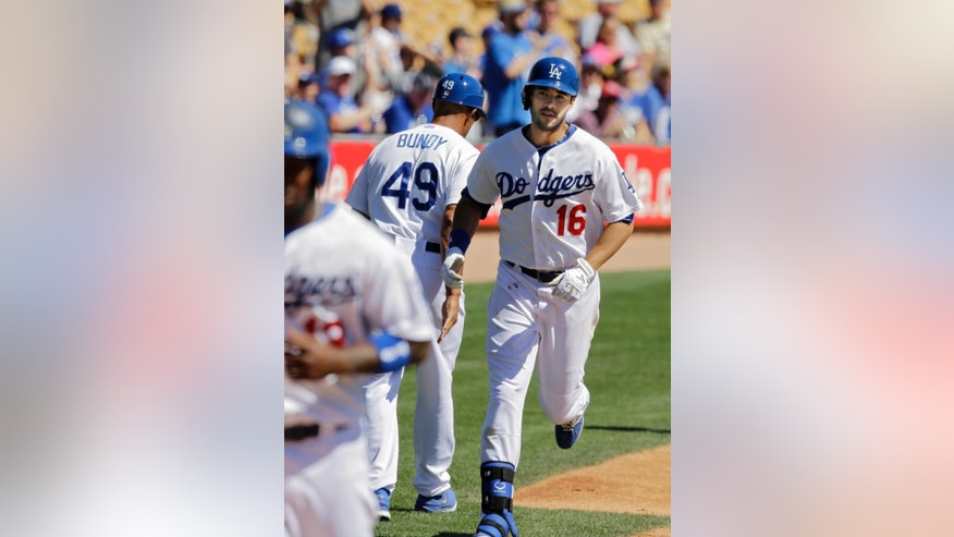 Los Angeles Dodgers' Andre Ethier (16) trots home after his two-run home run off Oakland Athletics starting pitcher Jarrod Parker in the first inning of a spring exhibition baseball game Monday, March 10, 2014, in Glendale, Ariz. (AP Photo/Mark Duncan)