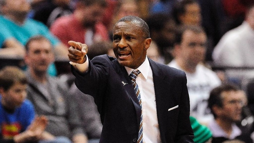 Toronto Raptors head coach Dwane Casey shouts out to his team during the first half of an NBA basketball game against the Minnesota Timberwolves, Sunday, March 9, 2014, in Minneapolis. The Raptors won 111-104. (AP Photo/Stacy Bengs)