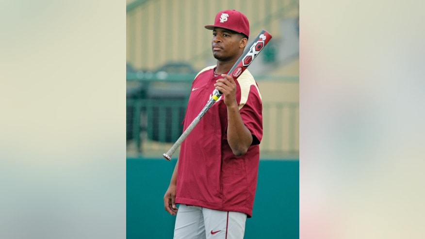 Florida State pitcher Jameis Winston waits to take batting practice before an NCAA college baseball game against South Florida Tuesday, March 4, 2014, in Tampa, Fla. (AP Photo/Chris O'Meara)
