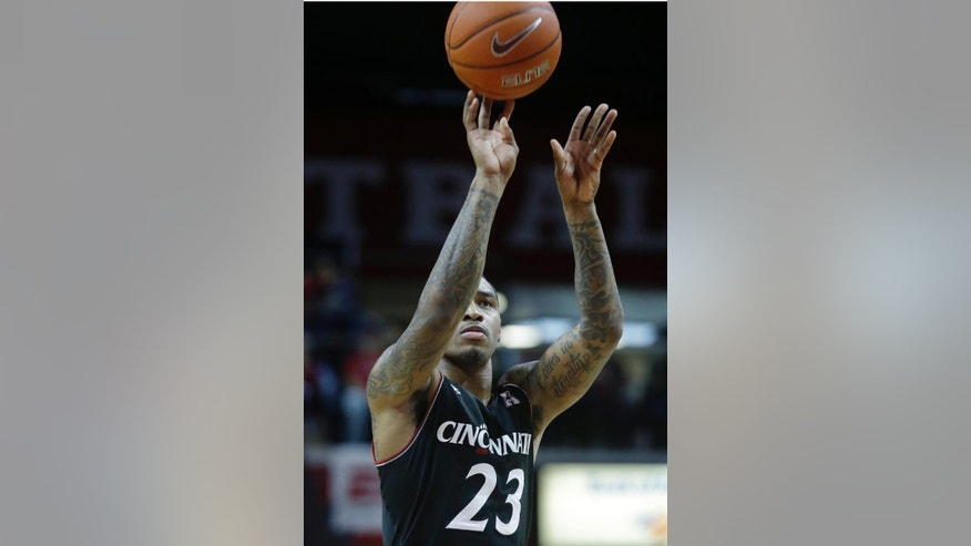 Cincinnati guard Sean Kilpatrick (23) takes a shot during the second half of an NCAA college basketball game against Rutgers Saturday, March 8, 2014, in Piscataway, N.J. Kilpatrick had 24 points in Cincinnati's 70-66 win. (AP Photo/Mel Evans)