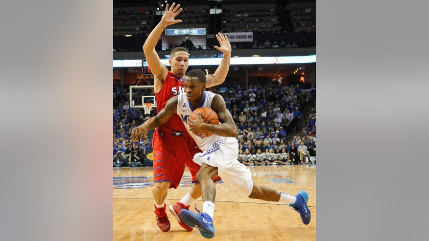 Memphis guard Joe Jackson, front, drives to the basket against SMU guard Nic Moore in the second half of an NCAA college basketball game Saturday, March 8, 2014, in Memphis, Tenn. Memphis won 67-58. (AP Photo/Lance Murphey)