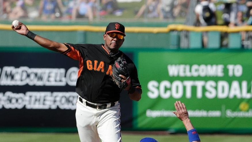 Chicago Cubs' Chris Coghlan, right, breaks up a double as San Francisco Giants second baseman Tony Abreu over throws first during the seventh inning of a spring exhibition baseball game in Scottsdale, Ariz., Monday, March 10, 2014. (AP Photo/Chris Carlson)