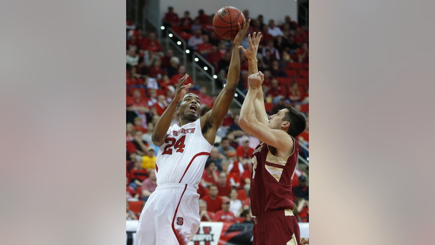 N.C. State's T.J. Warren (24) drives to the basket as Boston College's Alex Dragicevich (23) defends during the first half of N.C. State's game against Boston College at PNC Arena in Raleigh, N.C., Sunday, March 9, 2014. (AP Photo/The News & Observer, Ethan Hyman)