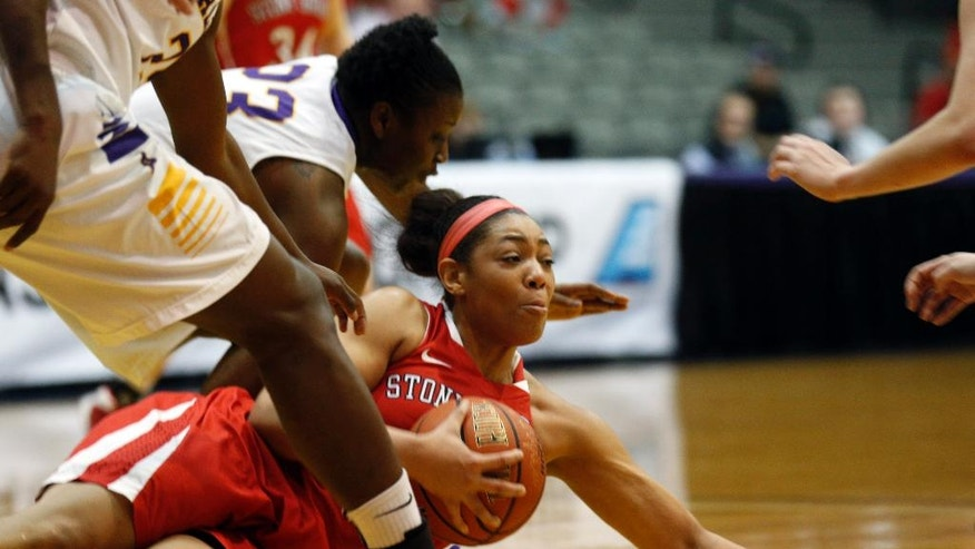 Stony Brook forward Sabre Proctor (13) grabs the loose ball in front of Albany defenders during the first half of an NCAA America East college championship basketball game on Monday, March 10, 2014, in Albany, N.Y. (AP Photo/Mike Groll)