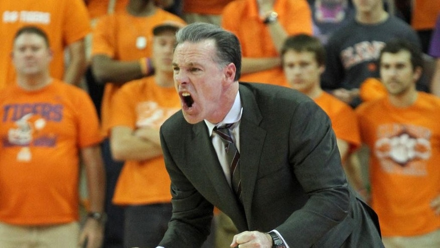 Pitt head coach Jamie Dixon reacts during an NCAA college basketball game against Clemson at Littlejohn Coliseum in Clemson, S.C. on Saturday, Mar. 8, 2014. Pitt won in overtime, 83-78. (AP Photo/Anderson Independent-Mail, Mark Crammer) GREENVILLE NEWS - OUT; SENECA JOURNAL - OUT