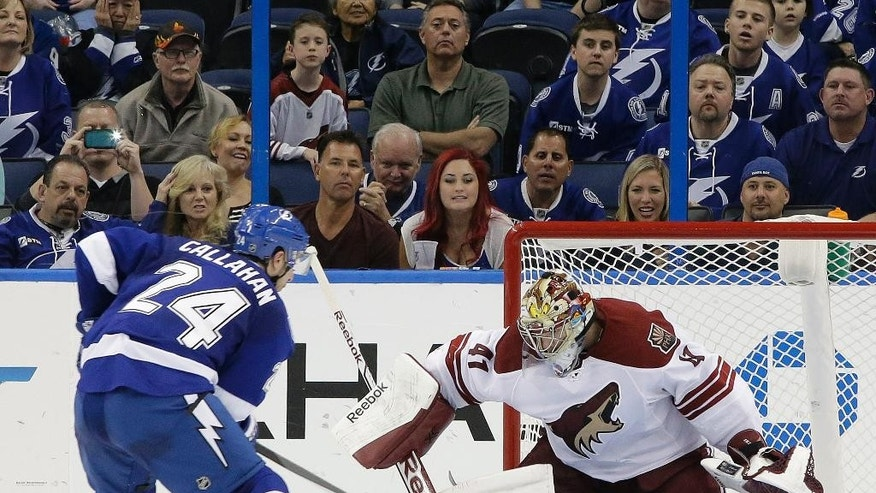 Phoenix Coyotes goalie Mike Smith (41) stops Tampa Bay Lightning right wing Ryan Callahan (24) during a shoot out in an NHL hockey game Monday, March 10, 2014, in Tampa, Fla. The Coyotes won the game 4-3. (AP Photo/Chris O'Meara)