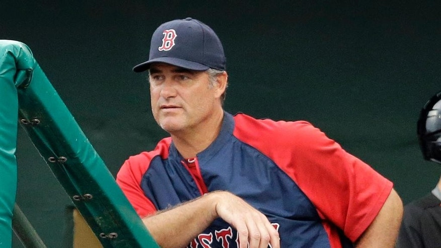 Boston Red Sox manager John Farrell watches from the dugout steps during the seventh inning of an exhibition spring training baseball game against the Miami Marlins, Thursday, March 6, 2014, in Jupiter, Fla. (AP Photo/Jeff Roberson)