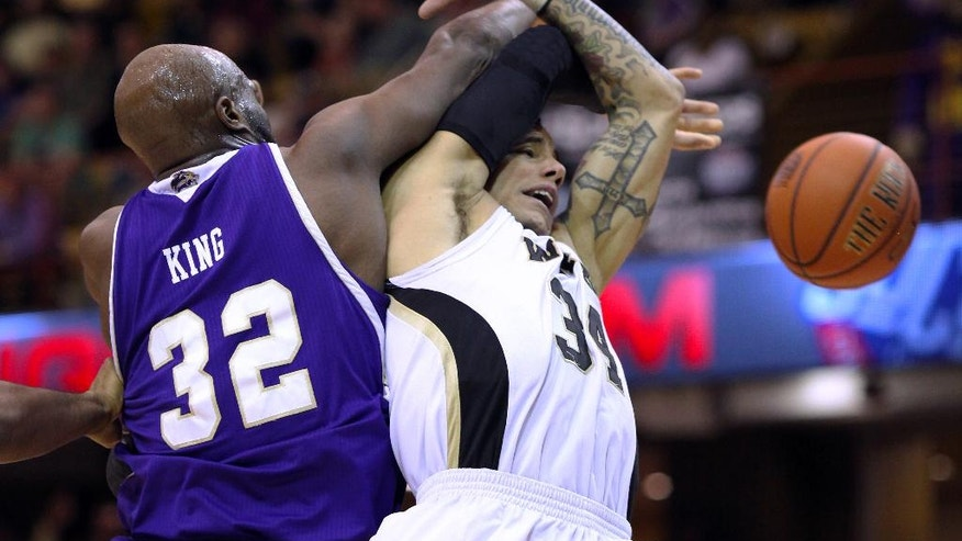 Western Carolina's Tawaski King (32) tries to block the shot of Wofford's Lee Skinner (34) during the first half of the NCAA college basketball championship game of the Southern Conference tournament in Asheville, N.C., Monday, March 10, 2014. (AP Photo/Adam Jennings)