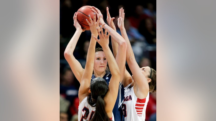 BYU's Jennifer Hamson, center, is double teamed by Gonzaga's Keani Albanez, left, and Kiara Kudron in the first half of an NCAA West Coast Conference women's tournament championship college basketball game, Tuesday, March 11, 2014, in Las Vegas. (AP Photo/Julie Jacobson)