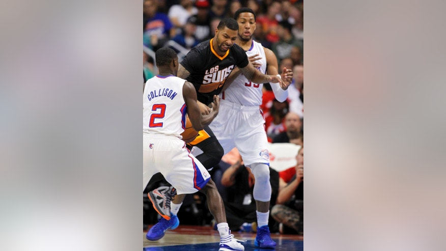 Los Angeles Clippers guard Darren Collison (2) steals the ball away from Phoenix Suns forward Marcus Morris, center, with Clippers forward Danny Granger, right, during the first half of an NBA basketball game Monday, March 10, 2014, in Los Angeles. (AP Photo/Alex Gallardo)