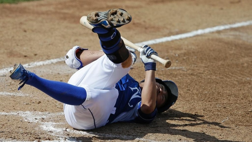 Kansas City Royals' Norichika Aoki falls to the ground after being hit by a pitch during the fifth inning of a spring exhibition baseball game against the Los Angeles Dodgers Tuesday, March 11, 2014, in Surprise, Ariz. (AP Photo/Darron Cummings)