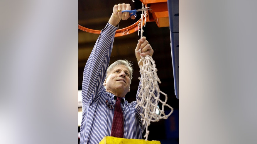 DePaul head coach Doug Bruno cuts down the net after defeating St. John's 65-57 during an NCAA college basketball game in the final of the 2014 Big East women's basketball tournament in Rosemont, Ill., Tuesday, March 11, 2014. (AP Photo/Nam Y. Huh)