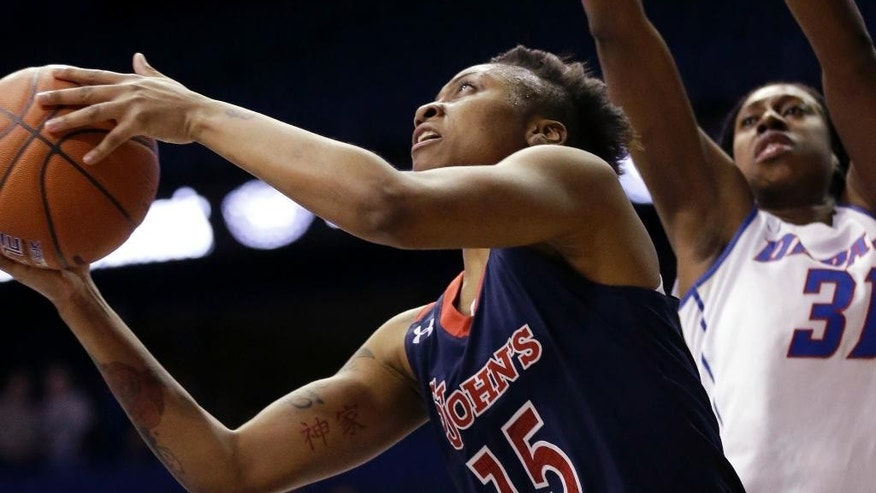 St. John's guard Danaejah Grant, left, drives to the basket DePaul forward Jasmine Penny during the first half of an NCAA college basketball game in the final of the 2014 Big East women's basketball tournament in Rosemont, Ill., Tuesday, March 11, 2014. (AP Photo/Nam Y. Huh)