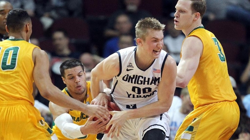 San Francisco's Matt Glover and BYU's Eric Mika struggle for control of the ball during the first half of a West Coast Conference tournament NCAA college basketball game Monday, March 10, 2014, in Las Vegas. (AP Photo/Isaac Brekken)