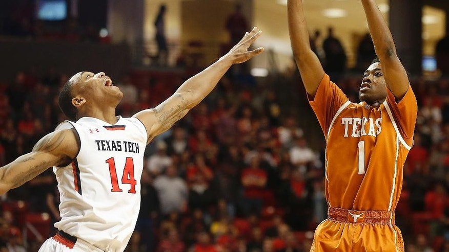 Texas' Isaiah Taylor shoots over Texas Tech's Robert Turner during their NCAA college basketball game in Lubbock, Texas, Saturday, Mar, 8, 2014. (AP Photo/Lubbock Avalanche-Journal, Zach Long) ALL LOCAL TV OUT
