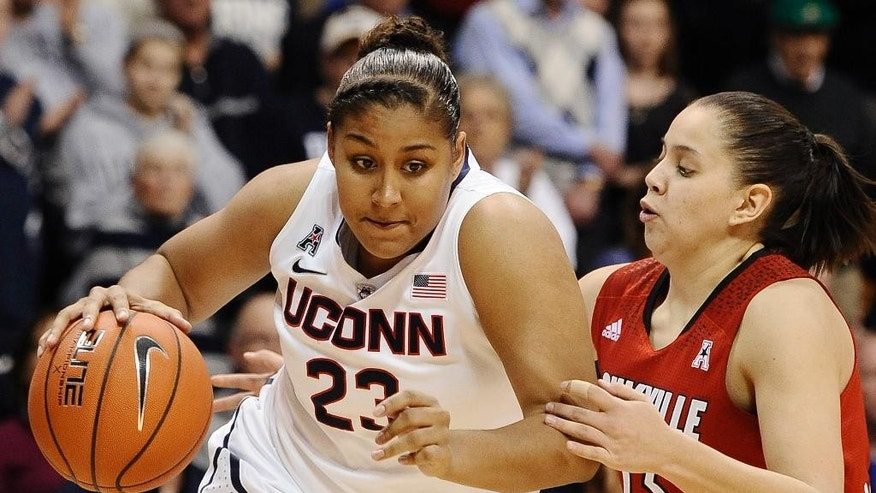Connecticut's Kaleena Mosqueda-Lewis, left, drives past Louisville's Shoni Schimmel during the second half of an NCAA college basketball game in the finals of the American Athletic Conference women's basketball tournament, Monday, March 10, 2014, in Uncasville, Conn. Connecticut won 72-52. (AP Photo/Jessica Hill)