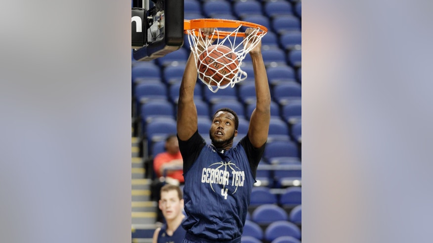 Georgia Tech's Robert Carter Jr. dunks during an NCAA college basketball practice for the Atlantic Coast Conference tournament in Greensboro, N.C., Tuesday, March 11, 2014. Georgia Tech plays Boston College in a first round game on Wednesday. (AP Photo/Chuck Burton)