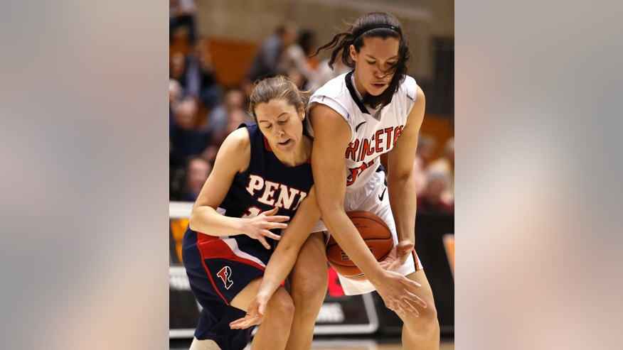 Penn guard Meghan McCullough, left, and Princeton forward Kristen Helmstetter compete for the ball during the first half of an NCAA college basketball game, Tuesday, March 11, 2014, in Princeton, N.J. (AP Photo/Julio Cortez)