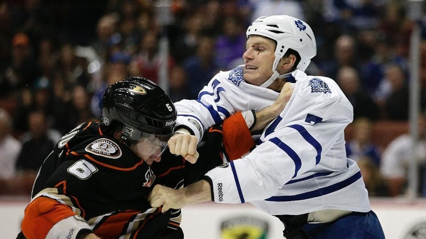 Toronto Maple Leafs' David Clarkson, right, fights with Anaheim Ducks' Ben Lovejoy during the first period of an NHL hockey game on Monday, March 10, 2014, in Anaheim, Calif. (AP Photo/Jae C. Hong)