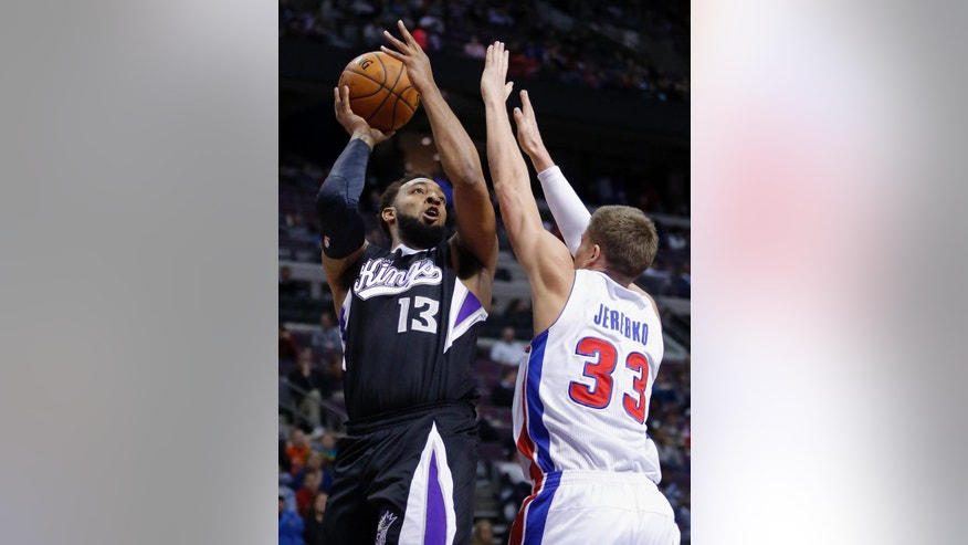 Sacramento Kings forward Derrick Williams (13) takes a shot against Detroit Pistons forward Jonas Jerebko (33) during the first half of an NBA basketball game, Tuesday, March 11, 2014, in Auburn Hills, Mich. (AP Photo/Duane Burleson)