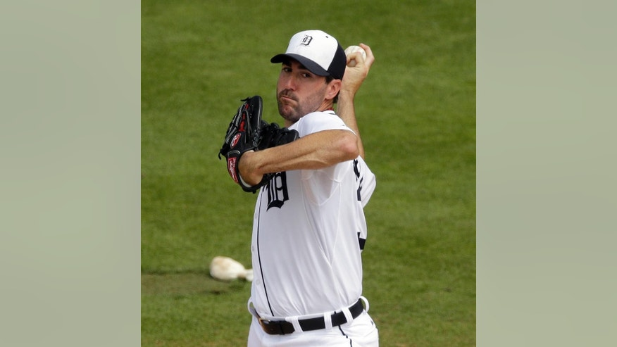Detroit Tigers starting pitcher Justin Verlander throws during the second inning of a spring exhibition baseball game against the Toronto Blue Jays in Lakeland, Fla., Tuesday, March 11, 2014. (AP Photo/Carlos Osorio)