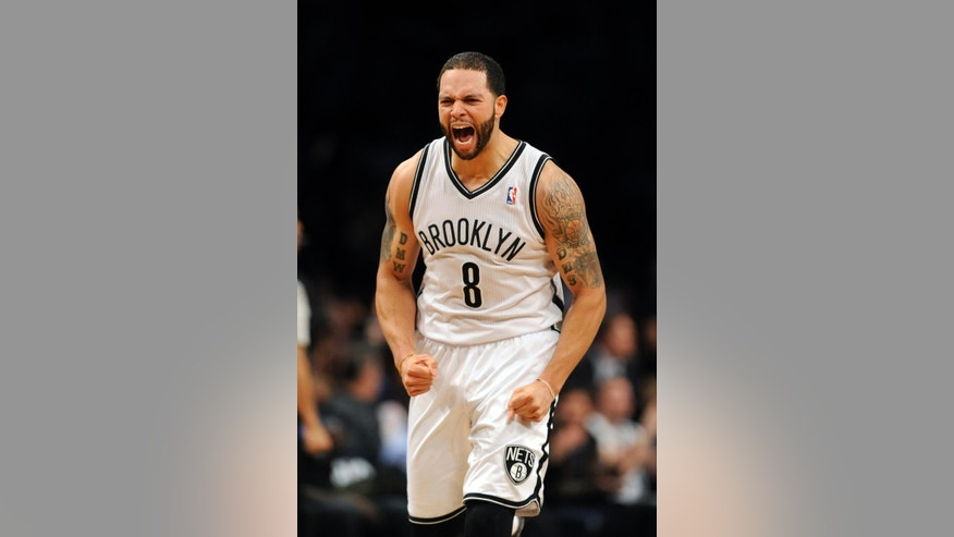 Brooklyn Nets' Deron Williams (8) celebrates his three pointer against the Toronto Raptors in the second half of an NBA basketball game on Monday, March 10, 2014 at Barclays Center in New York. The Nets won 101-97. (AP Photo/Kathy Kmonicek)